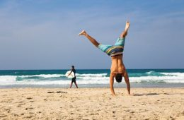 man on beach handstand